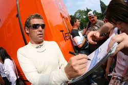 Tom Kristensen signs more autographs