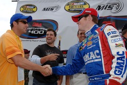 Actor Adam Sandler meets Brian Vickers while Josh Gracin, American Idol contestant, looks on