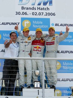 Podium: race winner Mattias Ekström with Jamie Green, Bernd Schneider and Hans-Jurgen Abt