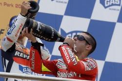 Podium: champagne for Dani Pedrosa and Marco Melandri