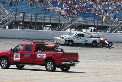 Cleaning crews blow the track off after pre-race activities