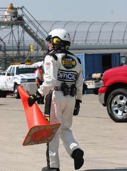 A NASCAR offical replaces the orange cone run over by Todd Kluever