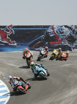 Start: Kenny Roberts leads the field into the corkscrew