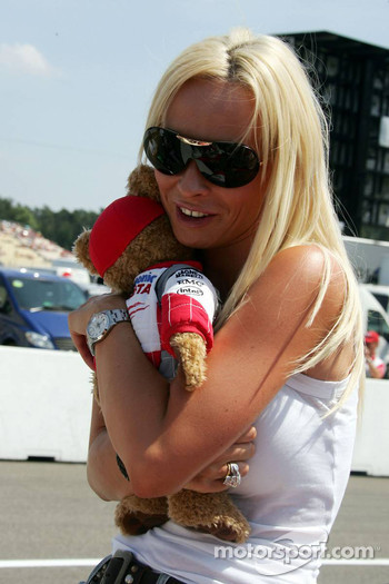 Cora Schumacher with the bear mascot of Toyota