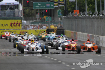 Robert Wickens and Matt Lee fight for the lead at the start