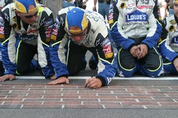 Lowe's Chevy crew members sign the bricks
