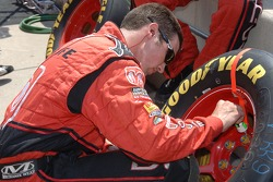 Evernham crew member prepares tires