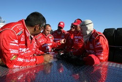 Chip Ganassi crew members prepare for the race