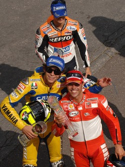 Podium: race winner Loris Capirossi with Valentino Rossi and Dani Pedrosa