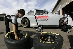 Hendrick Motorsports team members work on one of their cars