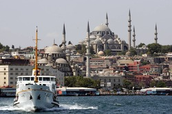 The Blue Mosque is seen behind a boat on the Golden Horn Bay in downtown Istanbul