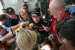Kimi Raikkonen is interviewed by the press