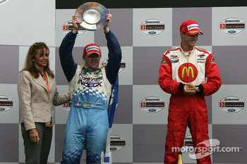 Podium: race winner Sébastien Bourdais with Paul Tracy