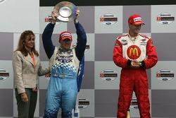 Podium: race winner Sébastien Bourdais with Paul Tracy