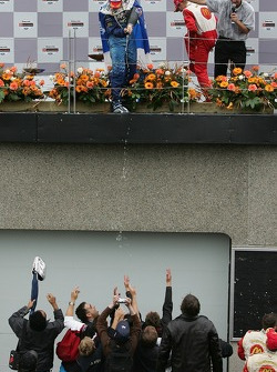 Podium: Paul Tracy pours champagne on the fans