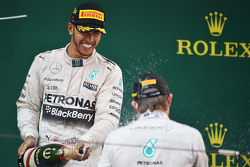 Race winner Lewis Hamilton Mercedes AMG F1 celebrates with the champagne on the podium with second placed team mate Nico Rosberg Mercedes AMG F1
