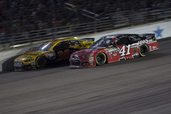 Kurt Busch, Stewart-Haas Racing Chevrolet and David Gilliland, Front Row Motorsports Ford