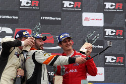 Podium Race 2: 1st position Stefano Comini, SEAT Leon, Target Competition, 2nd position Michel Nykjaer, SEAT Leon Target Competition and 3rd position Andrea Belicchi (ITA) SEAT Leon, Target Competition