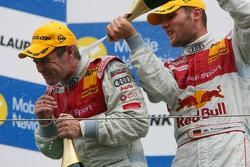 Podium: Martin Tomczyk gives race winner race winner Tom Kristensen a champagne shower