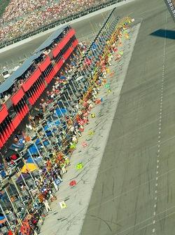 Teams await cars under yellow