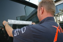 Spyker stickers are applied to Spyker MF1 Racing trucks