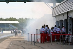 Smoke in the pitlane outside Toyota Racing