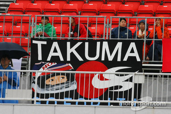 Takuma Sato fans in the grandstand