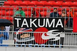 Takuma Sato fans in the grandstand