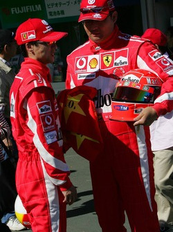 Two men dressed as Michael Schumacher