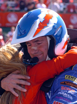 Glenn Seton gets a hug from his daughter