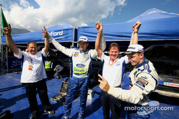 Marcus Gronholm and Mikko Hirvonen celebrate