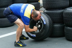 A Michelin tyre technician prepares wet tyres
