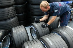 Red Bull Racing team member marks up tyres