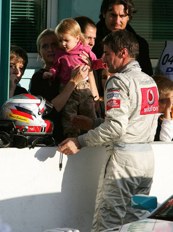 Bernd Schneider with his girlfriend Svenja Weber and their young daughter