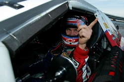 Brian Vickers signals to a teammate after setting the pole