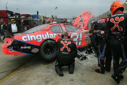 Crew members for Jeff Burton work on the car after crashing