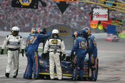 Michael Waltrip's crew try to find the problem with the engine