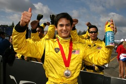 Alex Yoong celebrates winning race one