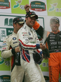 Podium: champagne for Andy Priaulx