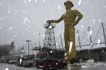 The Golden Driller stands sentry as the 21st Annual O'Reilly Chili Bowl Midget Nationals proceeds through inclement weather
