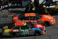 Tony Stewart and David Gilliland battle on pitlane