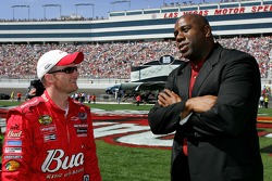 Dale Earnhardt Jr. talks with Magic Johnson