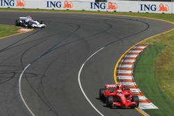 Kimi Raikkonen, Scuderia Ferrari, F2007 and Nick Heidfeld, BMW Sauber F1 Team, F1.07