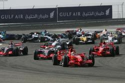 Felipe Massa, Scuderia Ferrari, F2007 and Lewis Hamilton, McLaren Mercedes, MP4-22, Kimi Raikkonen, Scuderia Ferrari, F2007