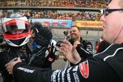 Jonny Reid, Driver of A1Team New Zealand is congratulated by the team