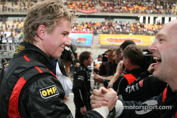 Nico Hulkenberg, Driver of A1Team Germany celebrates with the team after the race