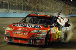 Race winner Jeff Gordon honors the late Dale Earnhardt
