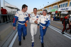 Bruno Famin, Stéphane Sarrazin and Michel Barge celebrate victory