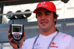 Fernando Alonso, McLaren Mercedes, with a team branded Kangaroo TV Set