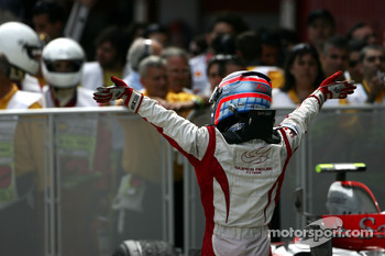 Takuma Sato celebrates point finish